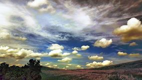 Hilltop Clouds. Hilltop behind our farm royalty free stock photo