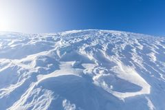 Hilltop covered in snow stock photography