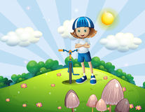 A hilltop with a female biker wearing a helmet Royalty Free Stock Photo