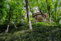 Hilltop gazebo in verdant spring Stock Photo