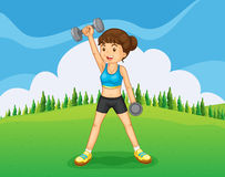 A hilltop with a girl exercising Stock Photo