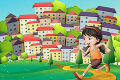 A hilltop with a girl running across the buildings Royalty Free Stock Photo