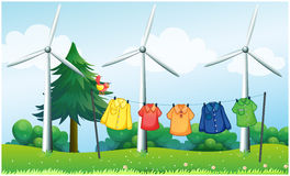 A hilltop with hanging clothes and windmills Royalty Free Stock Photos