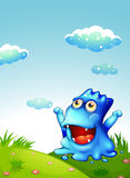 A hilltop with a happy monster looking at the sky Royalty Free Stock Photography