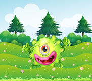 A hilltop with a playful monster. Illustration of a hilltop with a playful monster Stock Photos