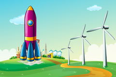 A hilltop with a rocket near the windmills Royalty Free Stock Images