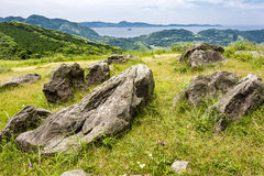 Hilltop with stones. A lot of stones on seashore green hilltop in Hirado, Nagasaki stock photography
