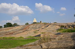 Hilltop Temple. On top of rocks in the Cloudy Blue sky background Stock Images
