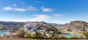 Hilltop town of Iznajar in Andalucia. White painted hilltop town of Iznajar by lake in Andalucia in Southern Spain royalty free stock photos