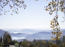 Hilltop view through autumn tree twigs Stock Photo