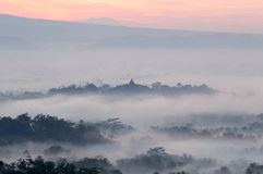 Hilltop view of Borobudur in mist Stock Image