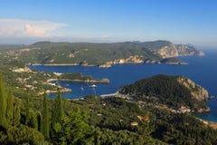 Hilltop view of Mediterranean sea coast and marina Corfu Greece. A hilltop view of the marina, harbor, and bay at Paleokastrttsa on the Mediterranean island of Stock Images