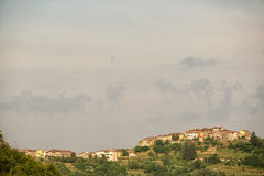 Hilltop village Tuscany Italy. View across green valley to a hilltop village Tuscany Italy Stock Images