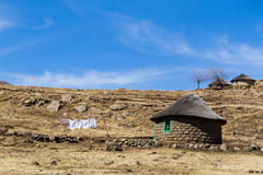 Hilltop Whites in Winter Sunshine. Traditional Basotho huts on a sunny winter day in rural Leribe, Lesotho royalty free stock photo