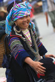 Hilltribe market in Sapa. SAPA, VIETNAM - JULY 7: hilltribe woman sells a hat to a customer at the market on July 7, 2009 in Sapa, Vietnam. Sapa is a frontier Royalty Free Stock Photo