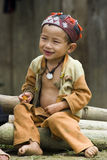 Hilltribe smile. SAPA, VIETNAM - JULY 8: unidentified hilltribe boy is in front of his house on July 8, 2009 in Sapa, Vietnam. Sapa is a frontier town where many Royalty Free Stock Images