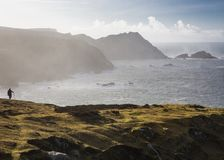 Hillwalking in spectacular Port, on the rugged west coast of Donegal near the village of Glencolmcille. With its many sea stacks, both rocky and sandy beaches royalty free stock photos