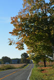 Hilly Country Road. A hilly two lane country road Royalty Free Stock Photos