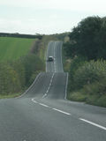 Hilly country road Stock Photography
