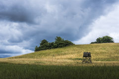 Hilly field with deerstand. Undulating landscape in Mecklenburg-Vorpommern with deerstand Stock Images