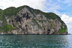 Hilly island at Andaman Sea with steep cliff Royalty Free Stock Image
