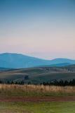Hilly  landscape at dusk Royalty Free Stock Image