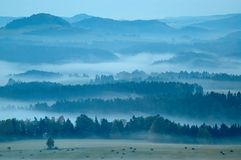 Hilly landscape with fog Royalty Free Stock Image