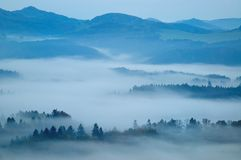 Hilly landscape with fog Royalty Free Stock Photography