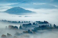 Hilly landscape with fog Royalty Free Stock Photos
