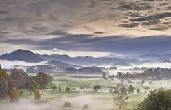 Hilly landscape with fog. Autumn morning hilly landscape with fog Royalty Free Stock Photos