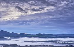 Hilly landscape with fog Stock Images