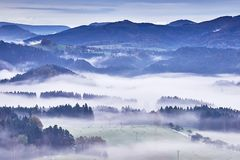 Hilly landscape with fog Royalty Free Stock Images