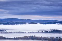 Hilly landscape with fog Stock Photos
