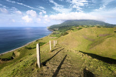 Hilly landscape of Rolling Hills in Batan island during evening hours with Mount Iraya in the background, Batanes, Philippines Stock Images