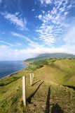 Hilly landscape of Rolling Hills in Batan island during evening hours with Mount Iraya in the background, Batanes, Philippines - 2 Stock Images