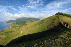 Hilly landscape of Rolling Hills in Batan island during evening hours with Mount Iraya in the background, Batanes, Philippines - 3 Royalty Free Stock Photography
