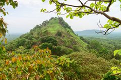 Hilly landscape view from sacred Dambulla Golden Cave Temple. Hilly rural landscape view from the top of sacred Dambulla Golden Cave Temple on Sri Lanka island Royalty Free Stock Photography