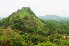 Hilly landscape view from sacred Dambulla Golden Cave Temple. Hilly rural landscape view from the top of sacred Dambulla Golden Cave Temple on Sri Lanka island Stock Image