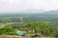 Hilly landscape view from sacred Dambulla Golden Cave Temple. Hilly landscape view from the top of sacred Dambulla Golden Cave Temple on Sri Lanka island Stock Photo