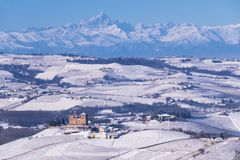 Snowy hilly landscape on the vineyards of the Langhe in the Unesco territory of Italy royalty free stock photos