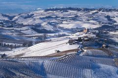 Snowy hilly landscape on the vineyards of the Langhe in the Unesco territory of Italy stock photo