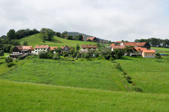 Hilly landscape, wasserkuppe. Green landscape with country village over hilly fields, germany Royalty Free Stock Image