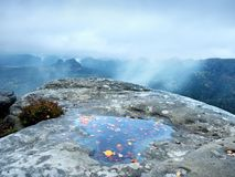 Hilly landscape in water mirror. Misty awakening in mountains  after rainy night Stock Photography