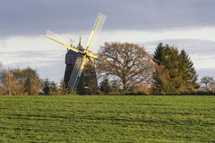 Hilly landscape with windmill in Lower Saxony Royalty Free Stock Photography