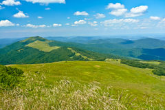 Hilly meadows and hills of Bieszczady Mountains. Green hilly meadows and hills of Bieszczady Mountains, Poland Stock Image