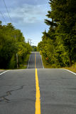 Hilly road in Canada. Hilly road in the countryside Royalty Free Stock Images