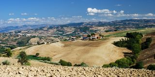 Hilly rural landscape. Overlooking rural landscape with hillside farming stock image