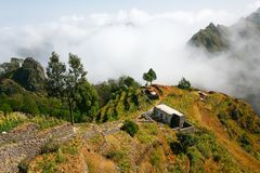 Santo Antao hilly landscape in clouds. Village houses royalty free stock images