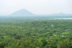Hilly landscape view from sacred Dambulla Golden Cave Temple. Hilly rural landscape view from the top of sacred Dambulla Golden Cave Temple on Sri Lanka island Stock Photos