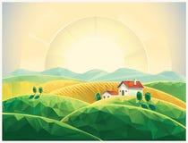 Hilly summer landscape. Summer countryside landscape with village. Sunrise Stock Images